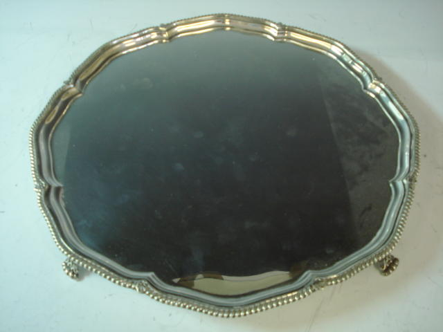 A silver circular salver by Harrison Bros., Sheffield 1931