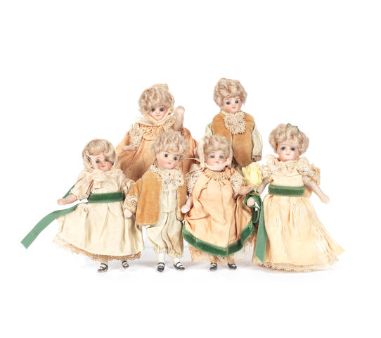 Six all-bisque dolls in original clothes 6