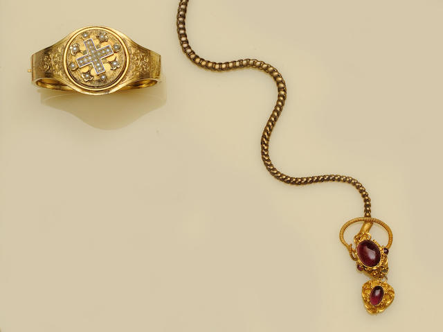 A mid Victorian serpent necklace and a Victorian hinged locket bangle (2)