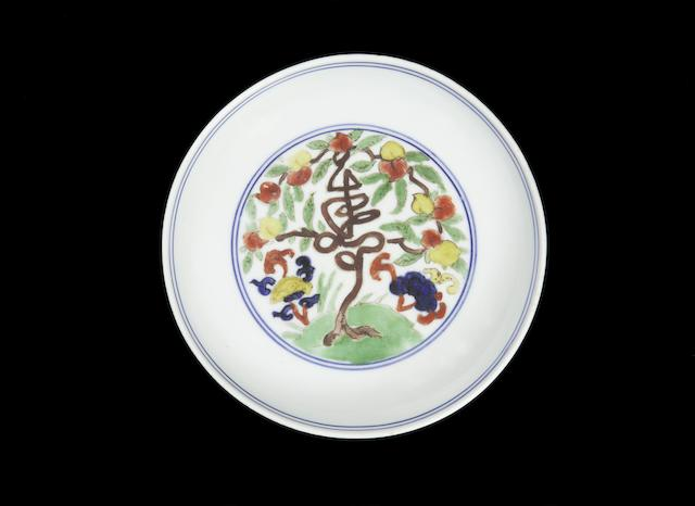 An extremely rare wucai 'shou and lingzhi' dish Jiajing six-character mark and of the period