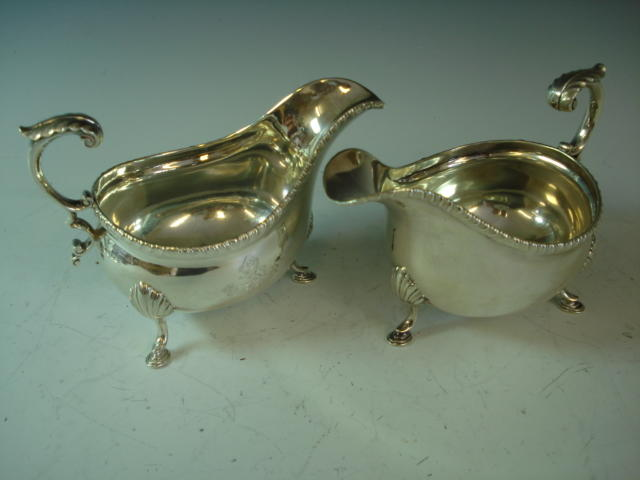 A pair of silver sauce boats, Sheffield 1933 - weight approx 24 ozs (720 grams)