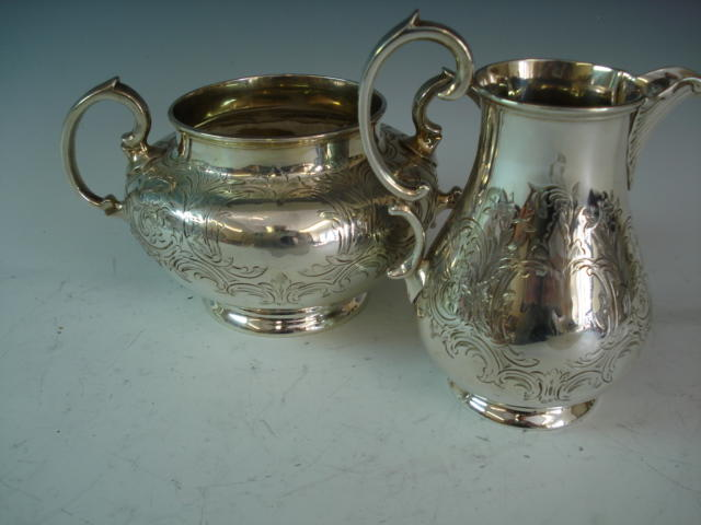A Victorian silver sugar bowl and milk jug by William Hunter, London 1854