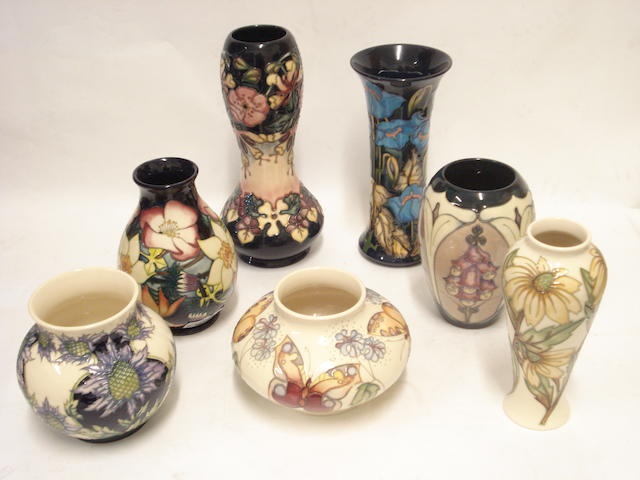 A collection of seven modern Moorcroft vases