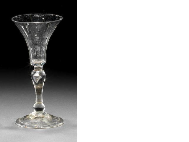 A light baluster wine glass, circa 1735