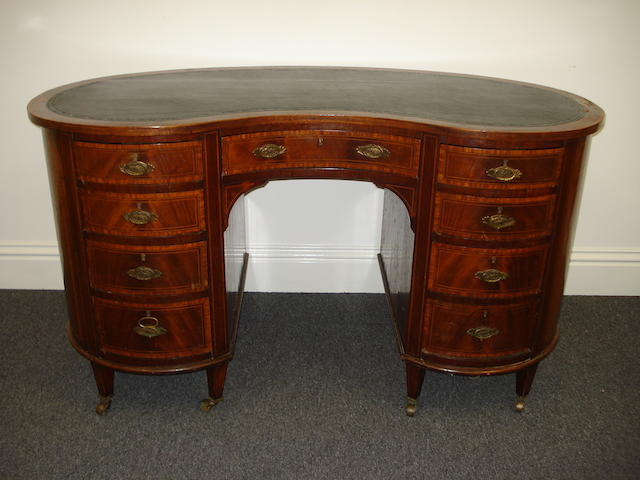 An Edwardian mahogany kidney shaped kneehole desk