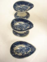 Three transfer printed eye baths and a garniture of three 19th century Staffordshire vases