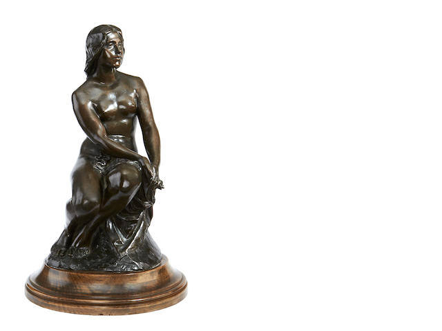 Bronze of a seated nude woman