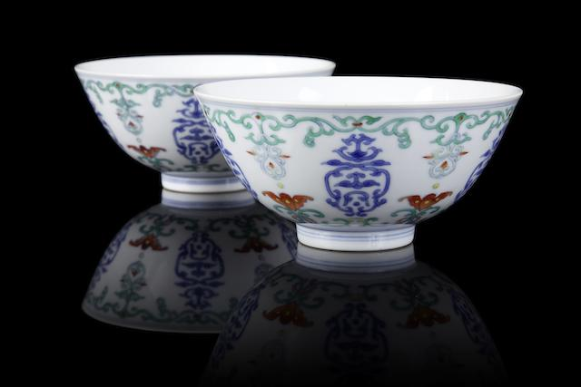 An exceptional pair of doucai 'wufu' bowls Yongzheng six-character marks and of the period