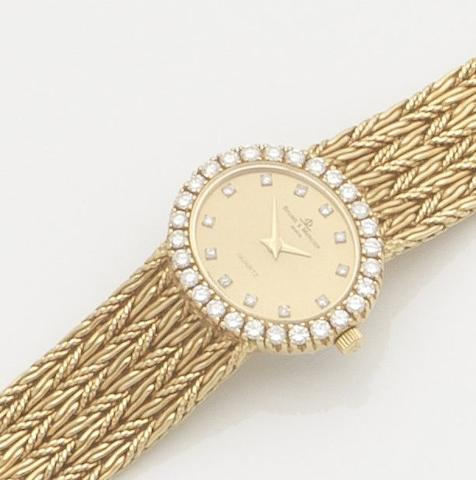 Baume & Mercier. A lady's 18ct gold and diamond set quartz bracelet watch 1980's