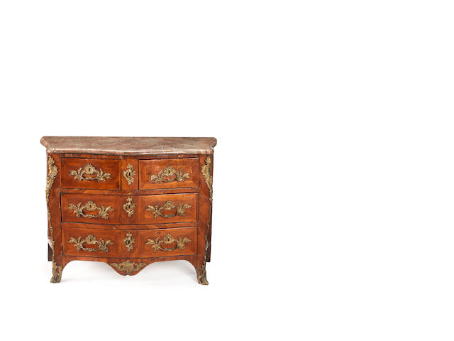 A French 18th century ormolu-mounted Louis XV Kingwood serpentine commode
