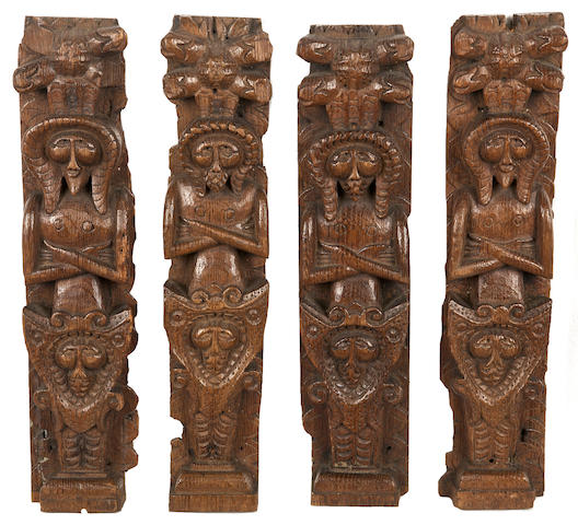A highly unusual and rare set of four late Elizabeth I carved oak pilasters or terms, circa 1590 - 1600