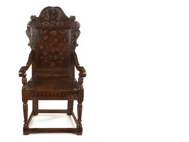 A James I/Charles I unusually large oak and marquetry inlaid panel back armchair Leeds area, Yorkshire, circa 1620-40
