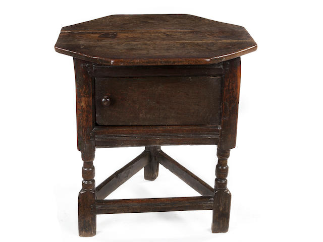 A rare Charles I joined oak joined triangular table/cupboard Circa 1640