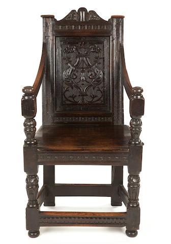 A rare Elizabeth I carved oak panel back armchair Circa 1570, possibly Salisbury