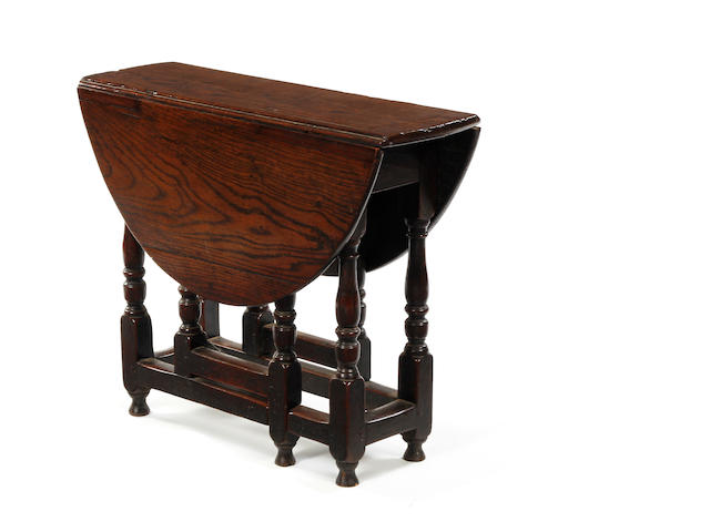 An early 18th century oak gateleg occasional table circa 1700-1720