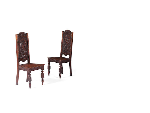 A pair of late Victorian walnut hall chairs