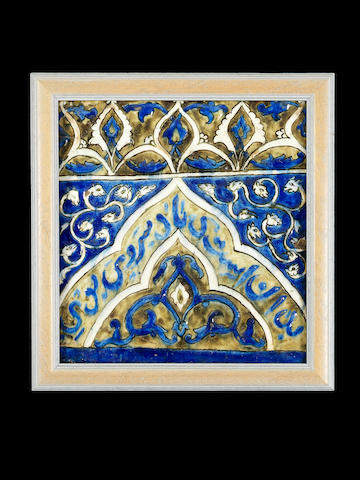 A Qajar underglaze-painted moulded pottery Tile Persia, 19th Century