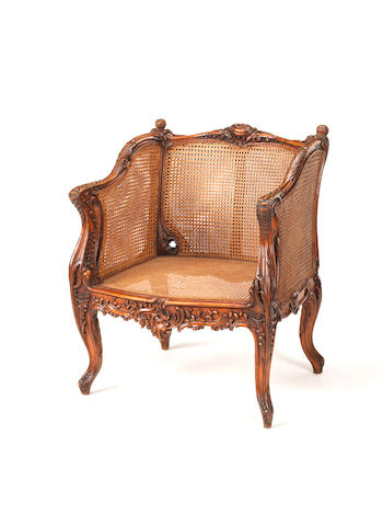 A 19th century carved walnut double caned chair