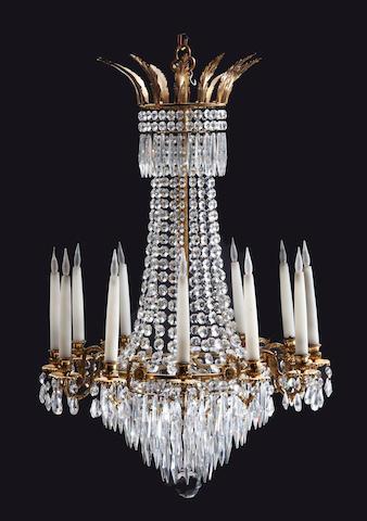 A late Victorian OSLER gilt-bronze and cut-glass 12 light chandelier