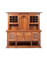 An Edwardian oak Art Nouveau style dining suite