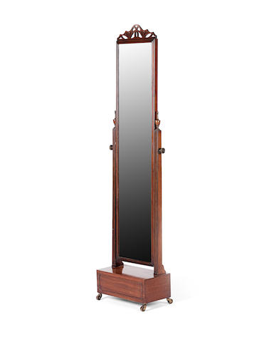 A mahogany cheval mirror, first quarter 20th century Attributed to Waring and Gillow Ltd.