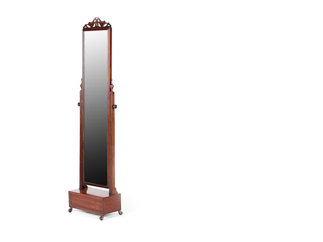 A mahogany cheval mirror, first quarter 20th century Attributed to Waring and Gillow Ltd
