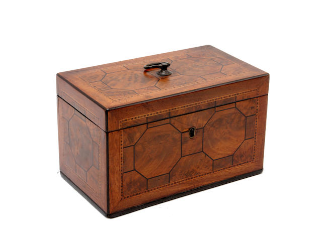 A George III mahogany, boxwood and ebony lined tea caddy