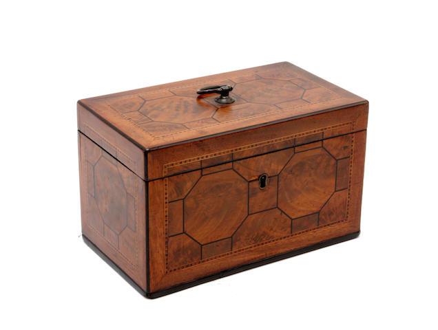 A George III mahogany, boxwood and ebony lined tea caddy