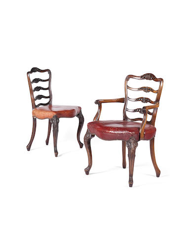A set of eight George III style walnut dining chairs