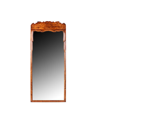 A Whytock & Reid walnut wall mirror, first quarter 20th century