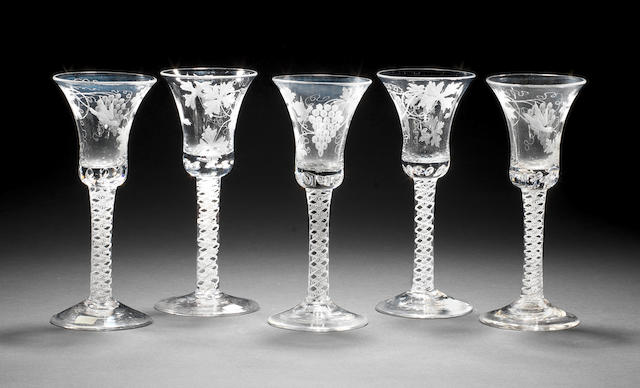 A set of five opaque twist wine glasses, engraved bell bowls, circa 1770s, 18.2cm (5)