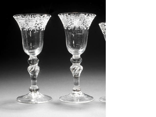 A pair of light baluster wines, engraved decoration, knopped stems, possibly Newcastle, circa 1750, one rim chip, 19.5cm high (2)