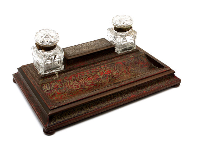 A late Victorian red tortoiseshell and cut brass inlaid desk stand