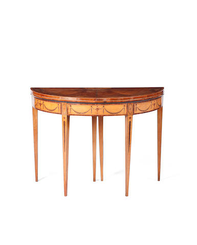 A George III satinwood and inlaid D shaped card table