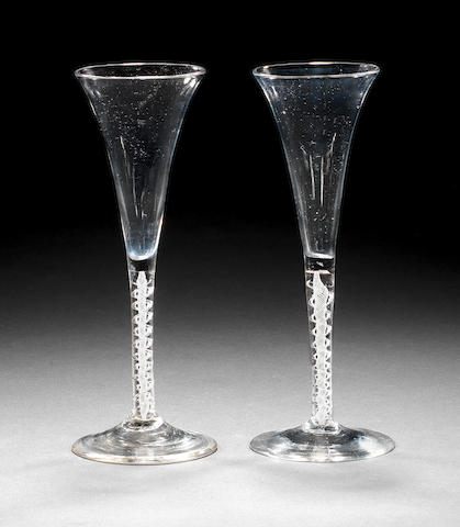 A pair of mixed-twist toasting glasses, circa 1760,
