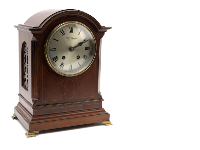 An Edwardian Mahogany cased mantel clock