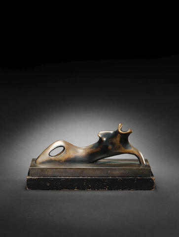 Henry Moore O.M., C.H. (British, 1898-1986) Reclining Figure: One Arm 33 cm. (13 in.) long (including bronze base)