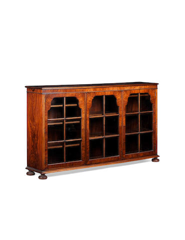 An early 20th century burr walnut and cross banded low bookcase