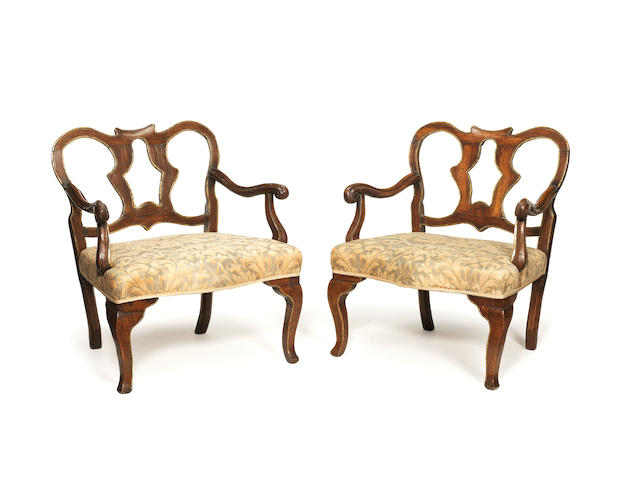 A pair of large Italian 18th century parcel-gilt walnut fauteuils 	  possibly Tuscan