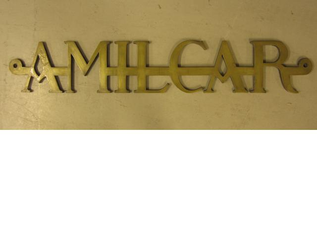 An Amilcar garage display emblem,