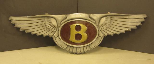 A winged Bentley emblem,