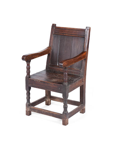 A late 17th century and later elm and oak armchair