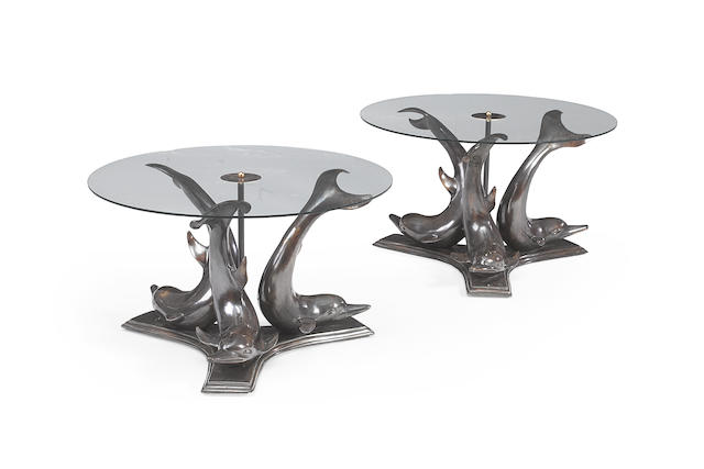 A pair of bronze and glass coffee tables