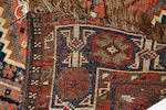 A Shiraz rug,with twin pole medallion, 141 x 113cm, another Shiraz rug, a Northwest Persian rug, a Caucasian rug and a Persian rug. (5)