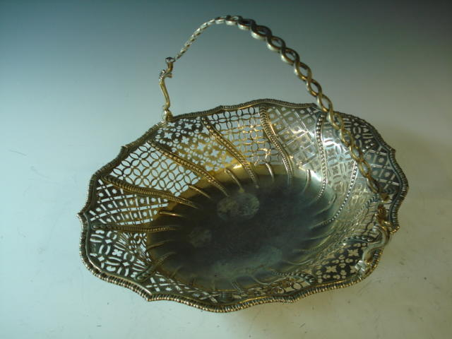 A George III silver oval swing-handle basket marks pierced, London circa 1765