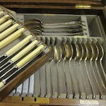 A canteen of electroplated rat-tail pattern flatware and cutlery,  by Walker and Hall,