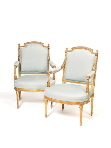 A pair of French late 19th century Louis XVI style giltwood fauteuils
