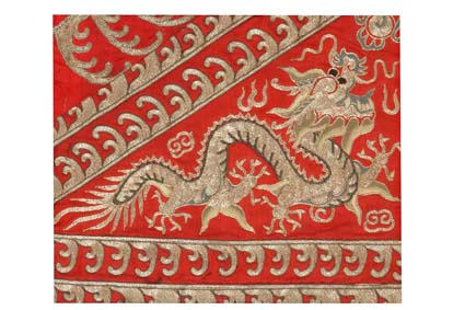 Three framed Chinese textile panels of dragons 19th/ 20th century
