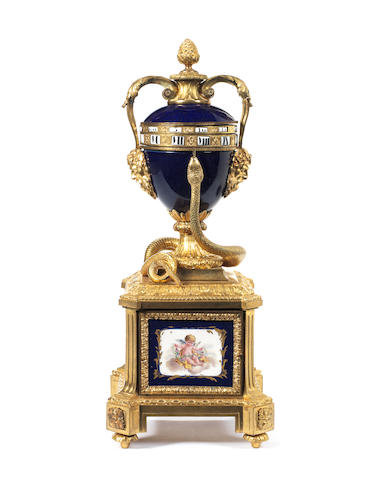 A late 19th century French porcelain mounted ormolu cercle tournant clock
