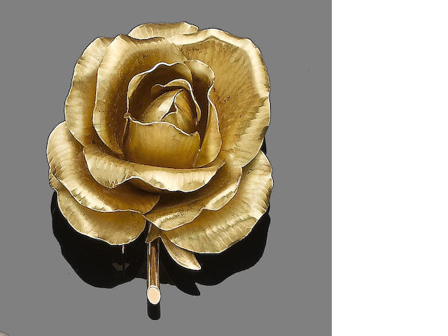A flower brooch, by Cartier,